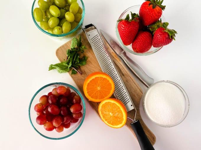 Ingredients for dressing a fruit salad with orange juice dressing.