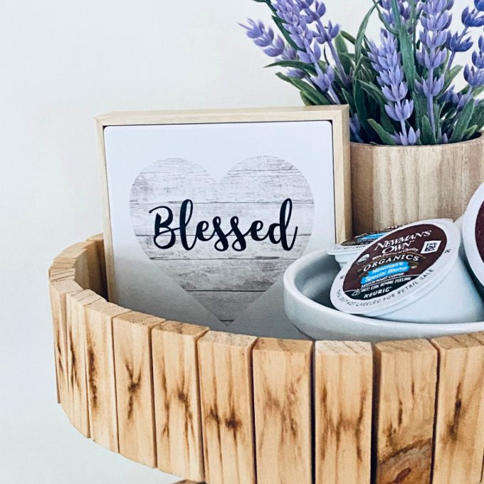 DIY Tiered Tray made from small wood blocks styled with a faux lavender plant, a small blessed sign, and coffee pods
