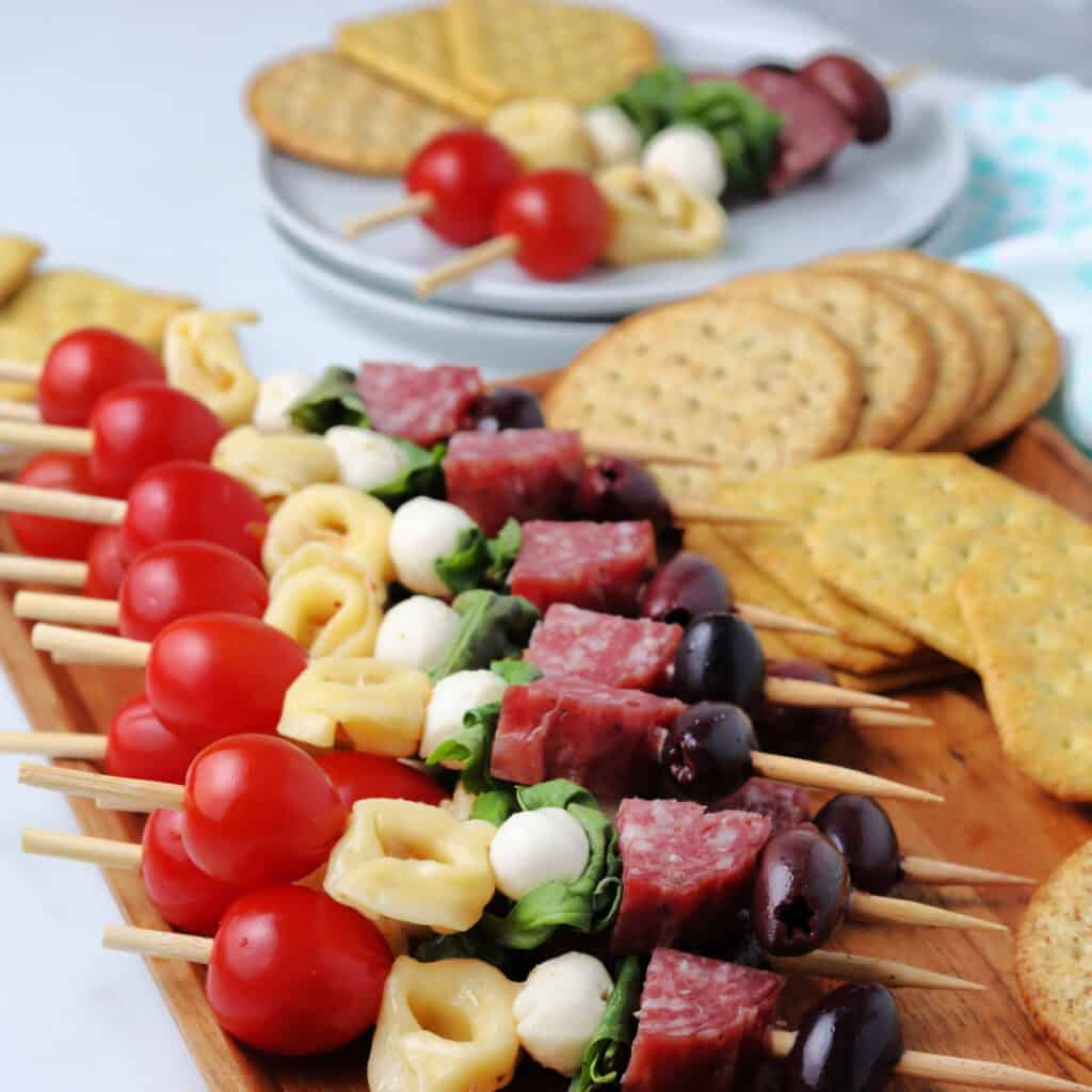 Close up image of Antipasto Kabobs on a cutting board.