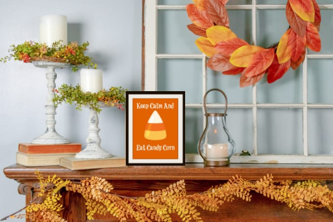fall mantle with framed candy corn printable