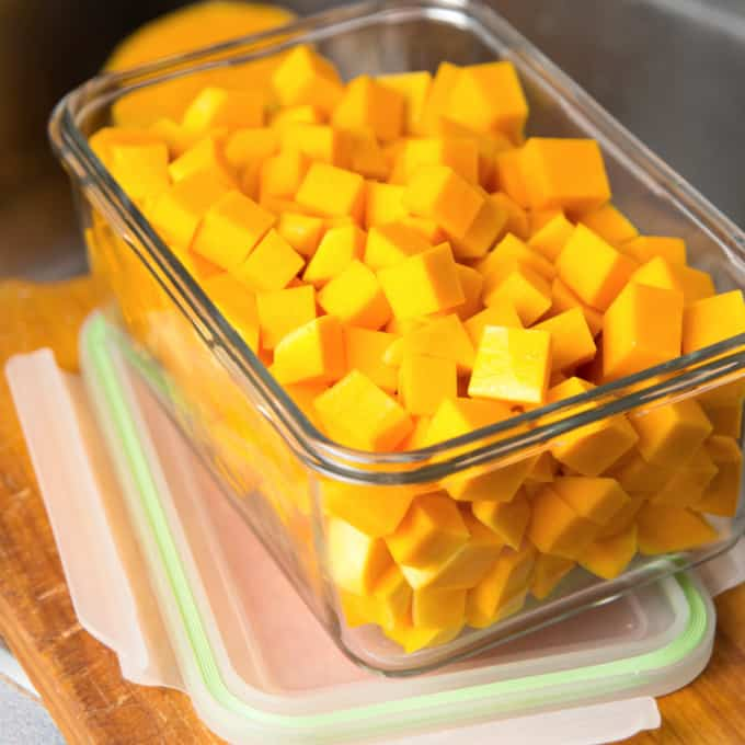 cubed butternut squash in a storage container
