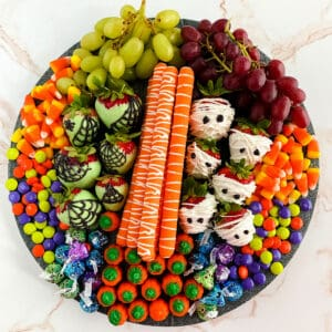 Square image of Halloween candies and snacks on a Halloween Charcuterie Board.