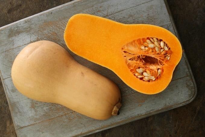halved butternut squash on a cutting board
